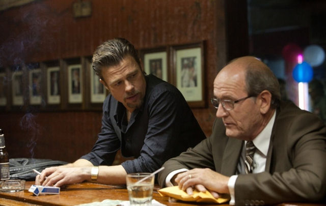 Brad Pitt and a weary Richard Jenkins get business done the hard way