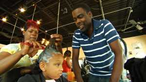 Chris Rock watches a young girl getting her hair relaxed (via Sodium hydroxide).